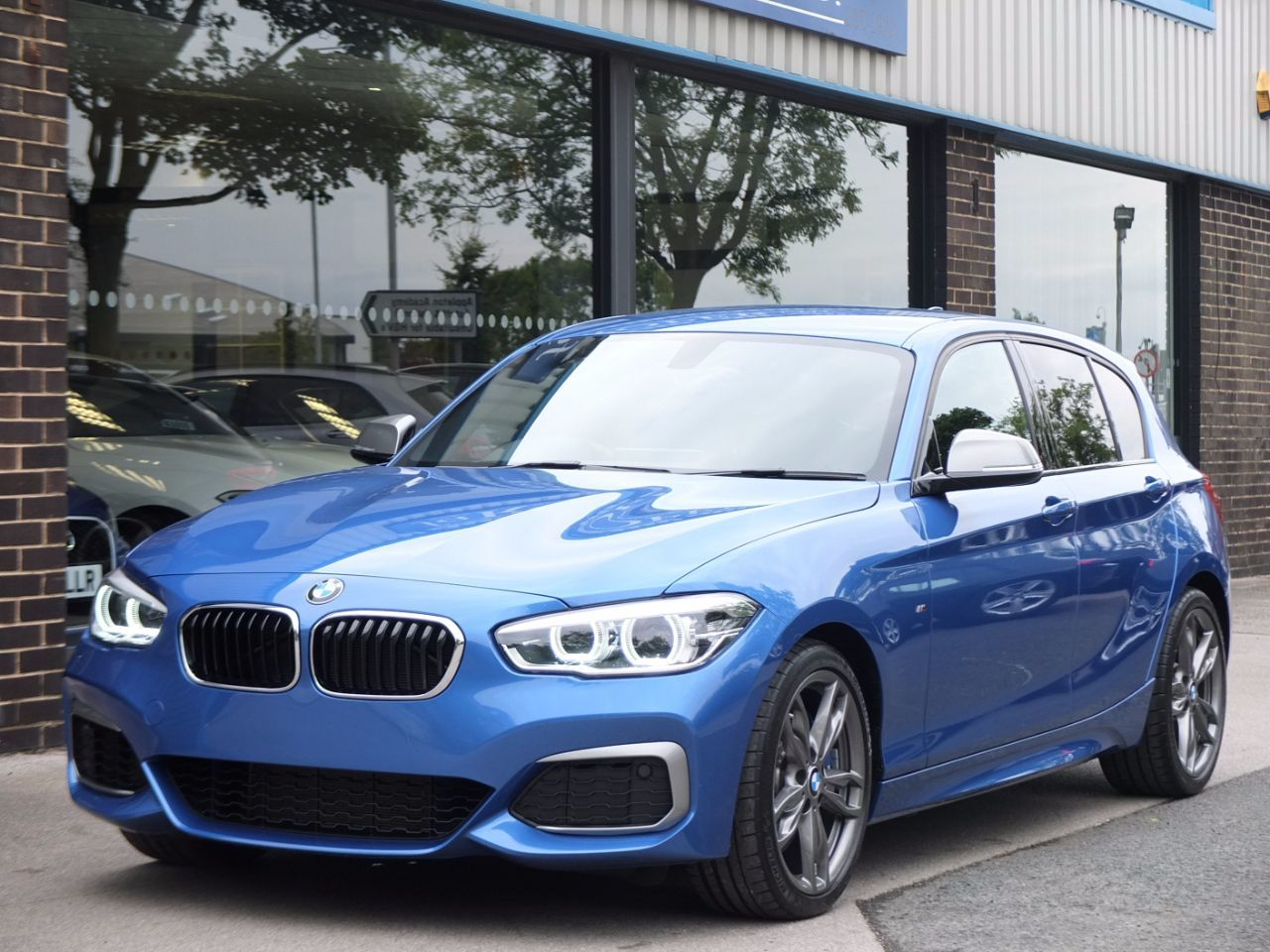 BMW 1 Series 3.0 M140i 5 door 340ps Auto Hatchback Petrol Estoril Blue MetallicBMW 1 Series 3.0 M140i 5 door 340ps Auto Hatchback Petrol Estoril Blue Metallic at fa Roper Ltd Bradford