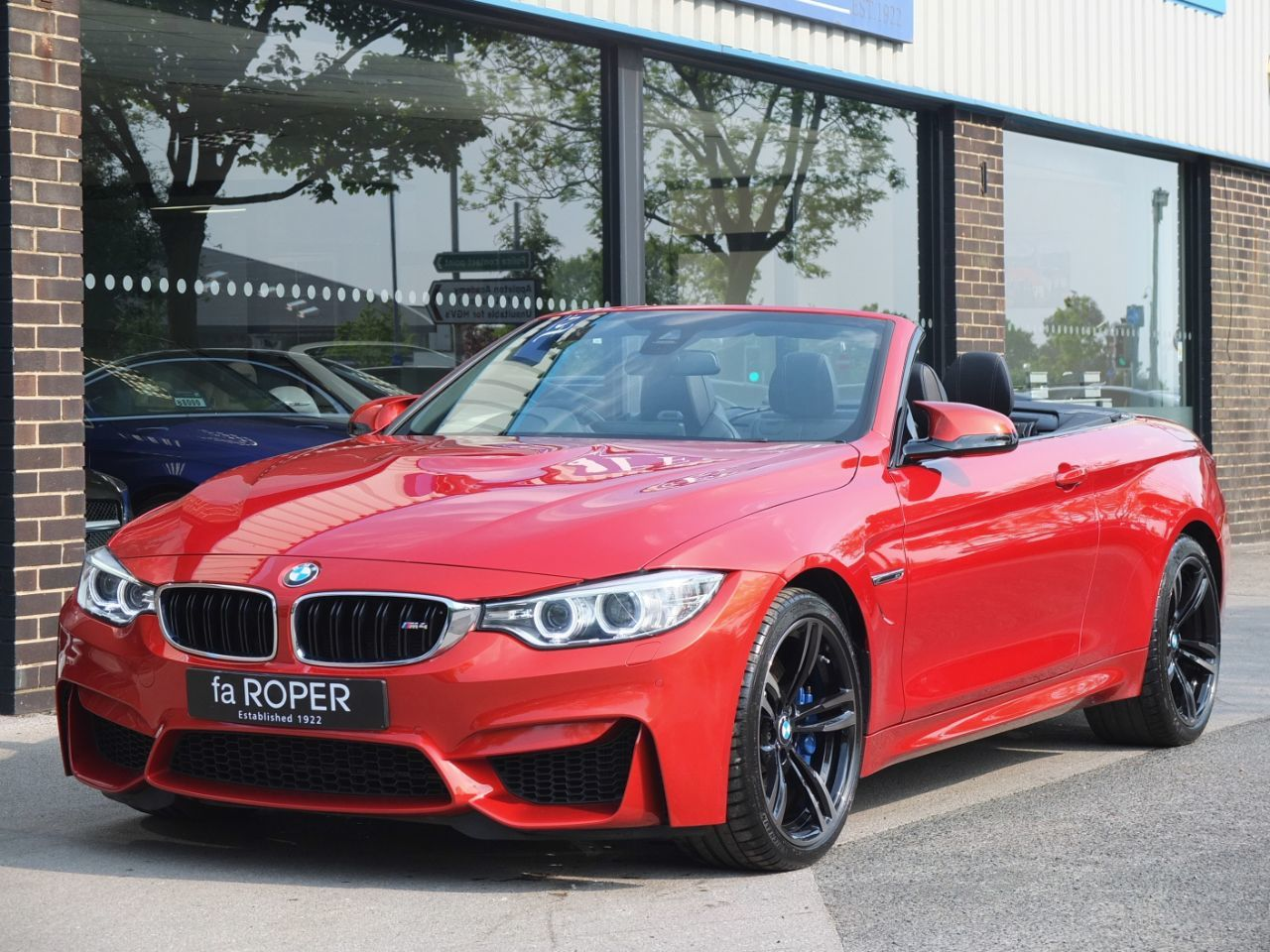 BMW M4 3.0 M4 Convertible DCT Convertible Petrol Sakhir Orange MetallicBMW M4 3.0 M4 Convertible DCT Convertible Petrol Sakhir Orange Metallic at fa Roper Ltd Bradford